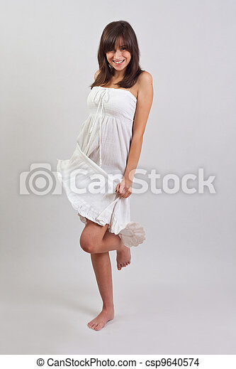 Woman standing in dress - csp9640574