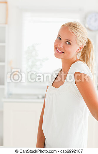 Woman standing in her kitchen - csp6992167