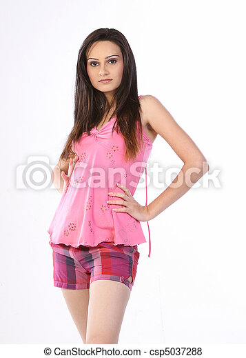 woman standing in pink dress - csp5037288