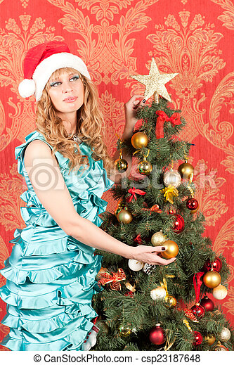 woman standing near a Christmas tree - csp23187648