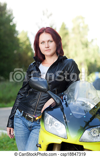 woman standing near bike - csp18847319