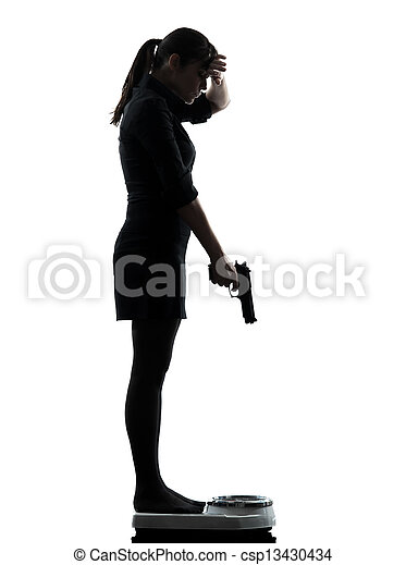 woman standing on weight scale despair aiming gun silhouette one