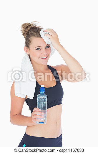 Woman standing while holding a towel to her forehead - csp11167033