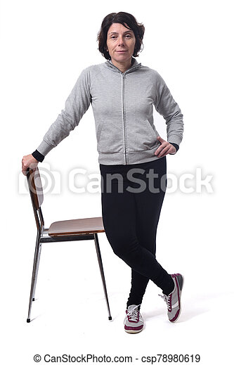 woman standing with a chair in white background - csp78980619