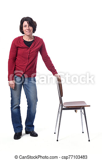 woman standing with a chair in white background - csp77103483