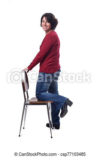 woman standing with a chair in white background - csp77103485