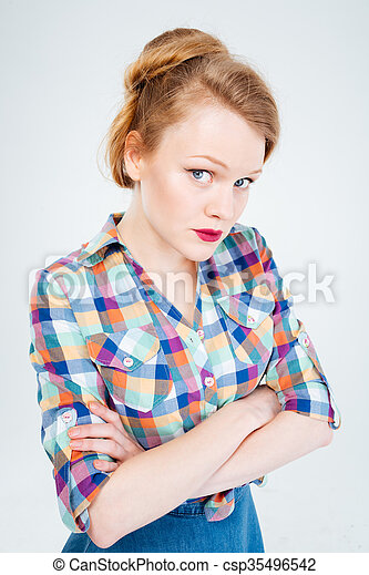 Woman standing with arms folded - csp35496542
