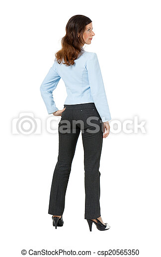 woman standing with his back on a white background - csp20565350