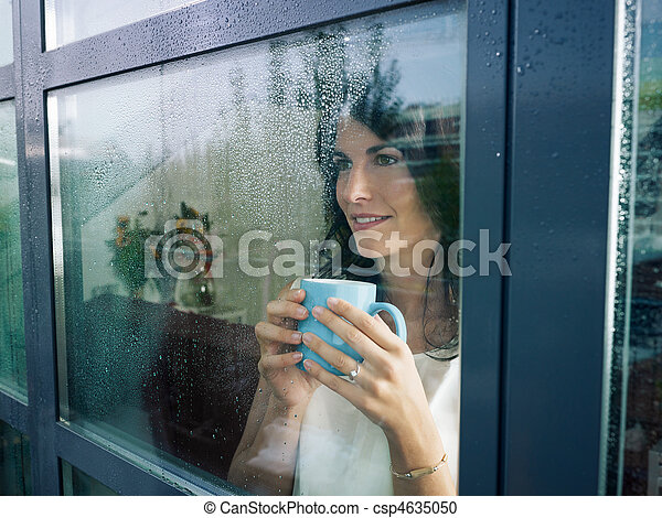 woman staring at the window - csp4635050