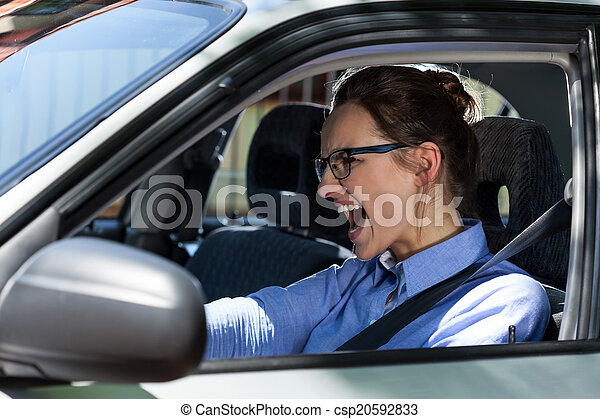 Woman stopping the car and screaming  - csp20592833