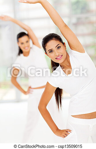 woman stretches her body for fitness - csp13509015