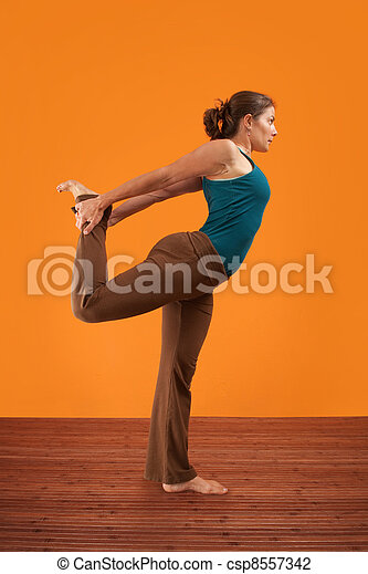 Woman Stretches Her Right Leg - csp8557342