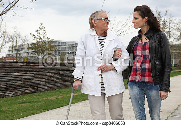 Woman strolling with an elderly lady - csp8406653