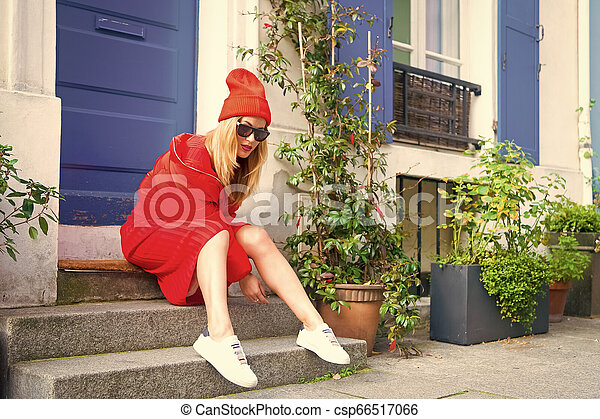 Woman stylish outfit sit on stairs near entrance house picturesque street in Paris. Paris known as capital of fashion confirms title stylish citizens. Changing trends keeps Paris magnet fashion world - csp66517066