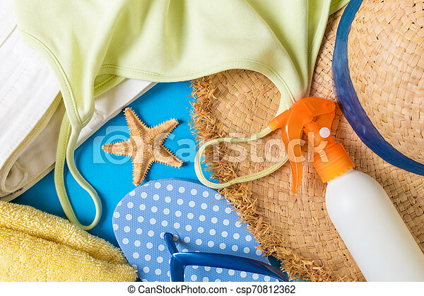 Woman summer outfit top view on blue background. Fashion vacations concept - csp70812362
