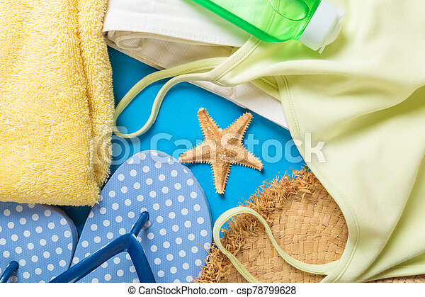 Woman summer outfit top view on blue background. Fashion vacations concept - csp78799628