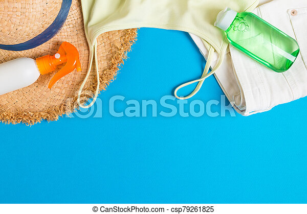 Woman summer outfit top view on blue background. Fashion vacations concept - csp79261825