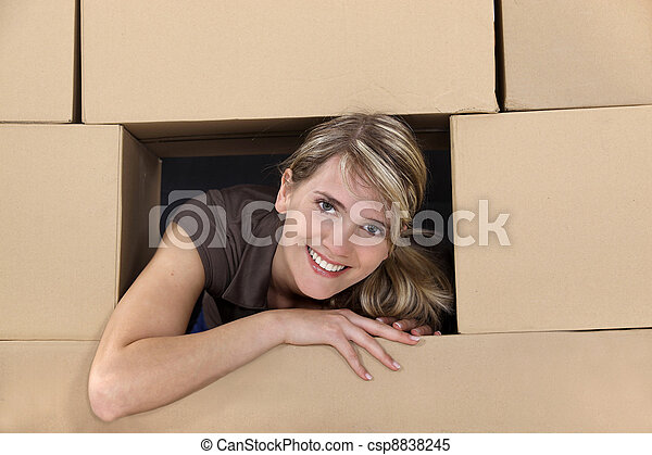 Woman surrounded by cardboard boxes - csp8838245