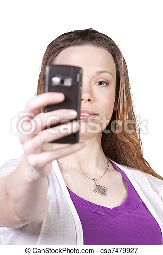 Woman taking  pictures from her cell phone - csp7479927