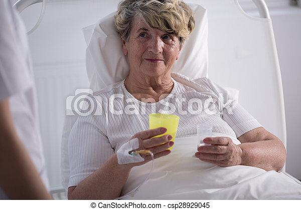 Woman taking pills - csp28929045