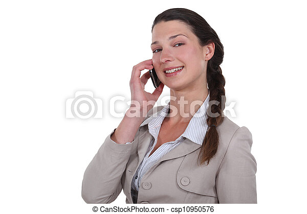 Woman talking on her mobile phone - csp10950576
