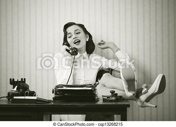 Woman talking on phone at desk - csp13268215
