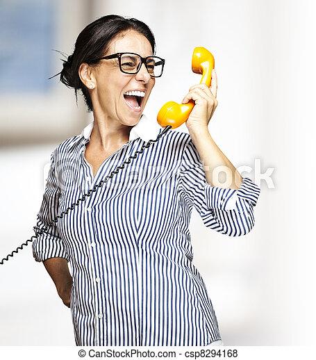 woman talking on telephone - csp8294168