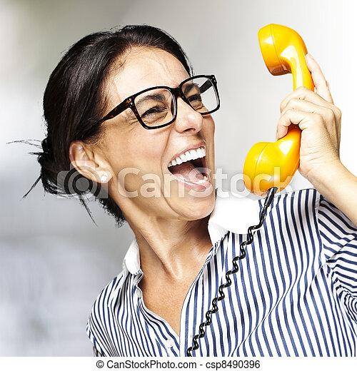 woman talking on telephone - csp8490396