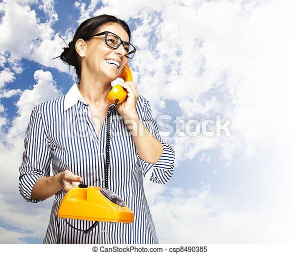 woman talking on telephone - csp8490385