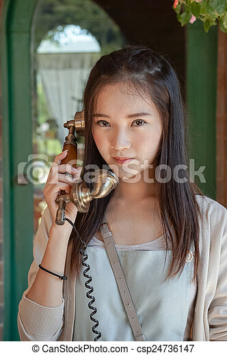woman talking on vintage telephone - csp24736147
