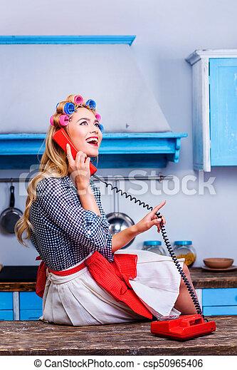 woman talking on vintage telephone - csp50965406