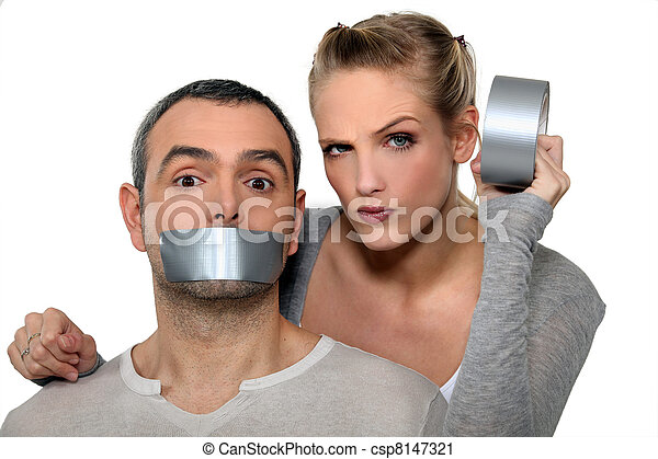 Woman taping-up mans mouth - csp8147321