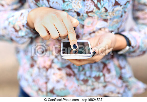 Woman texting sms on mobile phone - csp16824537