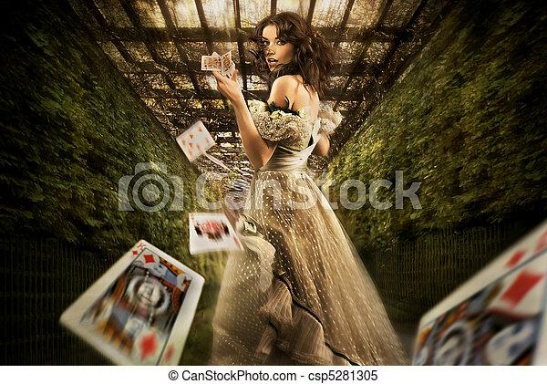 Woman throwing playing cards - csp5281305