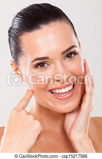 woman touching healthy face skin - csp15217566