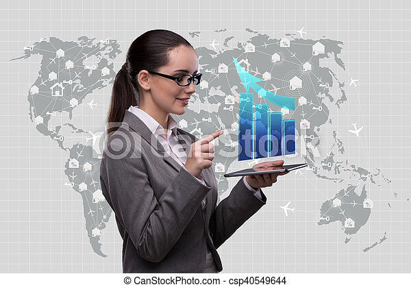 Woman trader with tablet and chart - csp40549644