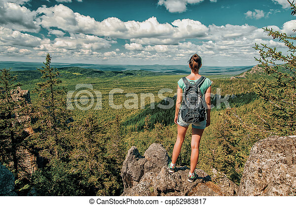 Woman Traveler with Backpack hiking in Mountains with beautiful landscape - csp52983817