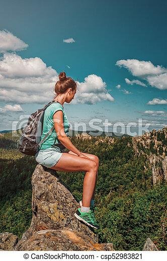 Woman Traveler with Backpack hiking in Mountains with beautiful landscape - csp52983821