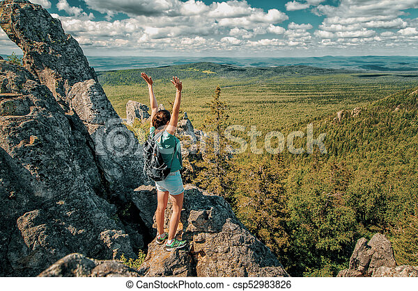 Woman Traveler with Backpack hiking in Mountains with beautiful landscape - csp52983826
