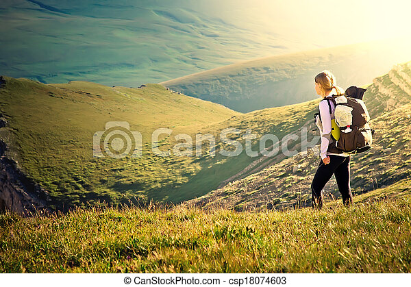 Woman Traveler with Backpack hiking in Mountains with beautiful summer landscape on background mountaineering sport lifestyle concept - csp18074603
