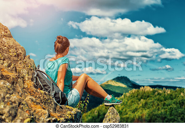 Woman Traveler with Backpack hiking in Mountains with beautiful landscape - csp52983831