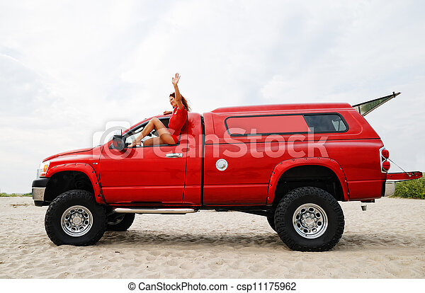 woman travelling on the red jeep - csp11175962