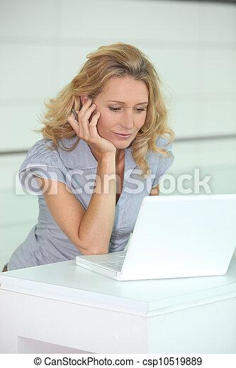 Woman using a computer - csp10519889