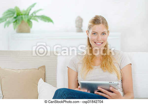 Woman using a tablet computer - csp31842704