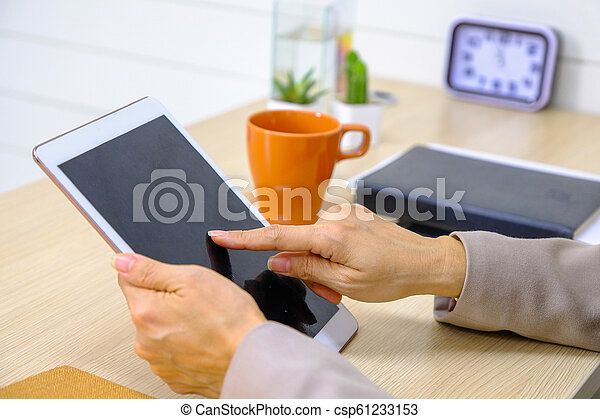 Woman Using Digital Tablet At Home - csp61233153
