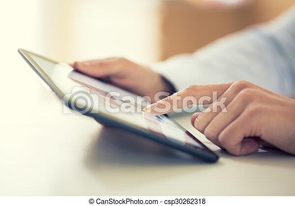 Woman using digital tablet indoor - csp30262318