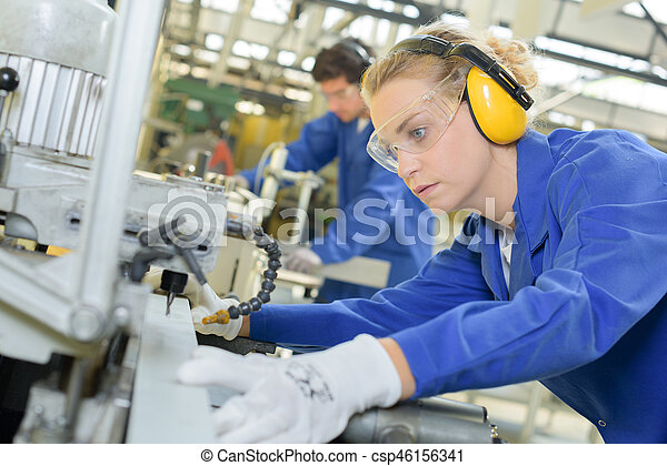 Woman using industrial machine - csp46156341