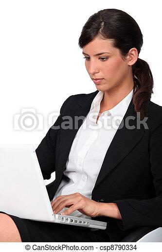 Woman using laptop computer - csp8790334
