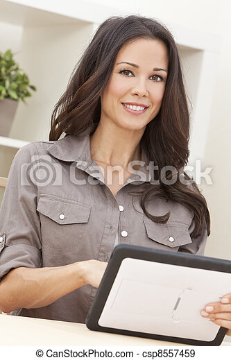 Woman Using Tablet Computer At Home - csp8557459