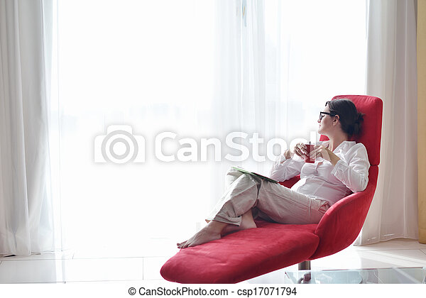 woman using tablet pc at home - csp17071794